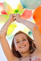 Portrait of a girl playing with balloons and smiling