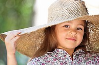 Portrait of a cute girl wearing a sunhat and smiling
