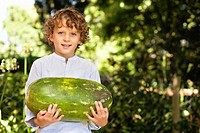 Portrait of a smiling boy holding a watermelon