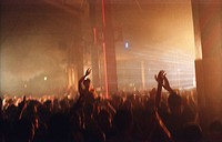 Silhouetted crowd and light at the Tribal Gathering Warehouse Party, Manchester, UK, August 2003.