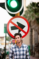 Man with No Entry sign and traffic light in the background