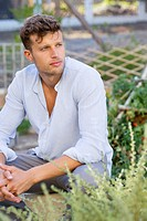 Contemplative man sitting in garden