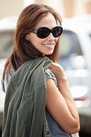 Portrait of a beautiful young woman wearing sunglasses