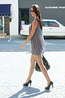 Side profile of a young woman walking