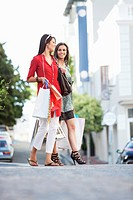Two young women walking with shopping bags