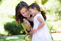 Woman and her granddaughter reading a text message