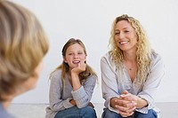 Mid adult woman talking to her son and daughter at home (thumbnail)