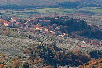 Umbrian landscape in winter, aerial view of village, valley and olive trees