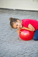 Portrait of a cute little girl playing with ball