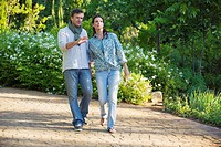 Happy mature couple walking in a garden (thumbnail)