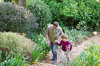 Father and son walking in a garden (thumbnail)