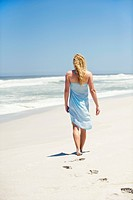 Rear view of a woman walking on the beach
