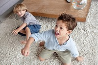Boys playing in home