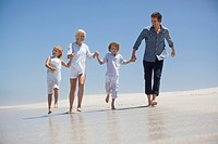 Family enjoying on the beach (thumbnail)