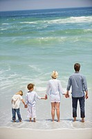 Family with two children standing on the beach