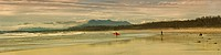 Panoramic of surfers on Long Beach, Vancouver Island, B.C., Canada