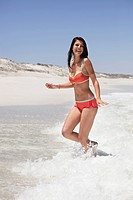 Woman enjoying on the beach (thumbnail)