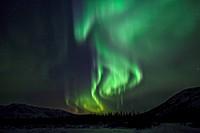 Aurora borealis over mountains in Whitehorse, Yukon, Canada
