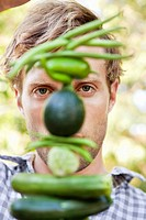 Young man holding vegetables