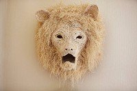 Close_up of a lion head decorated on a wall