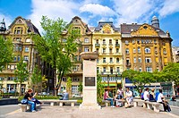 People relaxing at renovated Fövam ter square Budapest Hungary Europe
