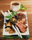 Glazed duck Magret with pan_fried mushrooms