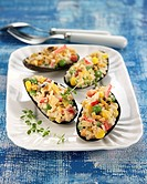 Mussels stuffed with corn and rice