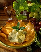White grapes with vanilla cream in a crisp tulip_shaped casing