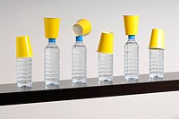 Plastic cups and bottles of water