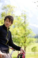 portrait of male cyclist having a break