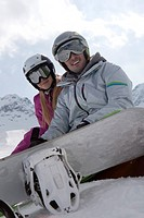 portrait of young snowboarder couple