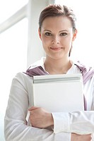 portrait of young businesswoman with documents