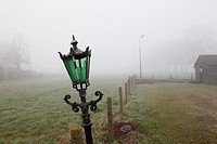 Lamp post in farm landscape. Netherlands