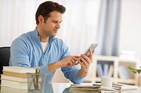 Man using digital tablet at home office