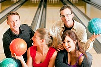 Friends bowling together