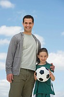 Portrait of father and daughter 8_9 with soccer ball