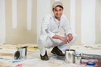 House painter stirring paint