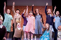 A group of young children performing in Aberystwyth Arts Centre stage school production of 'We'll Meet Again' , UK