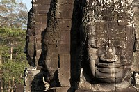 Large sculptures of heads on tower of Khmer temple, Bayon, Angkor Thom, Siem Riep, Cambodia