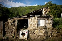 A broken washing machine blocks the door of an abandoned house located in the French Way that leads to Santiago de Compostela, Spain. Hundred of thous...