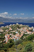 Kastellorizo  Dodecanese Islands  Greece  Aerial view overlooking the town, the 14th C Knights castle stands at the end of the promontory, mainland Tu...