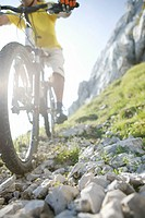Man on a mountainbike going downhill part of, selective focus