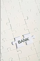 The word bank in the area of a missing jigsaw puzzle part