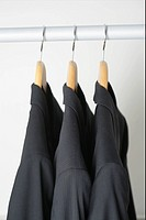 Jackets on clothes hanger in a row