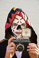Young woman with camera wearing mask, Melbourne, Victoria, Australia