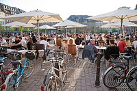 France, Alsace, Strasbourg, Petite_France, Place Benjamin Zix, View of people and bicycles at outdoors cafe pub
