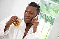 Young African Man Drinking Apple Juice