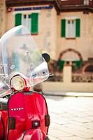 Vespa Piaggio parked in Bosa old town Sardinia, Italy