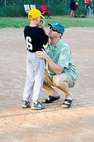 Injured youth baseball player comforted by his father  St Paul Minnesota MN USA