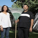 Couple standing in yard with rake